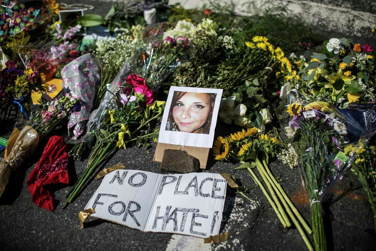 A makeshift memorial that includes a photo of Heather Heyer, who was killed, at the site where on Saturday a car plowed into a group of counter-protesters after a