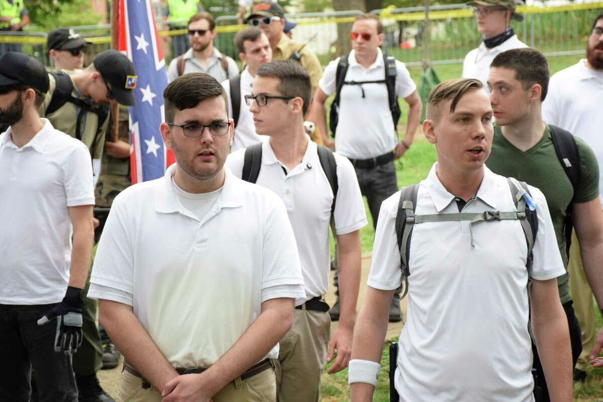 James Alex Fields Jr., left, in a crowd of white nationalists in Charlottesville, Va., Aug. 12, 2017. Hours later, the police say, he killed a 32-year-old woman and injured 19 other people by driving a car into a line of other cars. (Hawes Spencer/The New York Times) -- NO SALES; FOR EDITORIAL USE ONLY WITH VA RALLY DRIVER BY JONAH ENGEL BROMWICH AND ALAN BLINDER FOR AUG. 14, 2017. ALL OTHER USE PROHIBITED. -- ORG XMIT: XNYT4