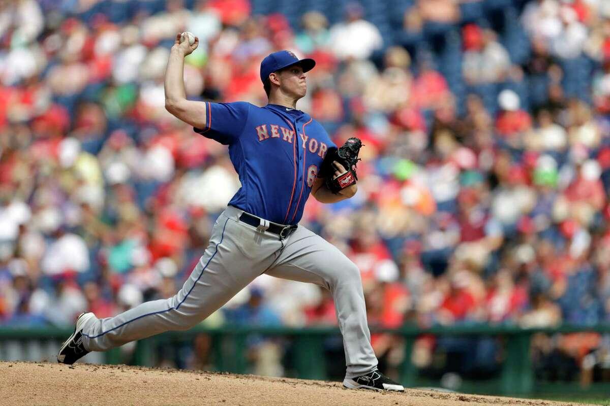 New York Mets' Chris Flexen pitches during the third inning of a baseball game against the Philadelphia Phillies, Sunday, Aug. 13, 2017, in Philadelphia. (AP Photo/Matt Slocum) ORG XMIT: PXS105