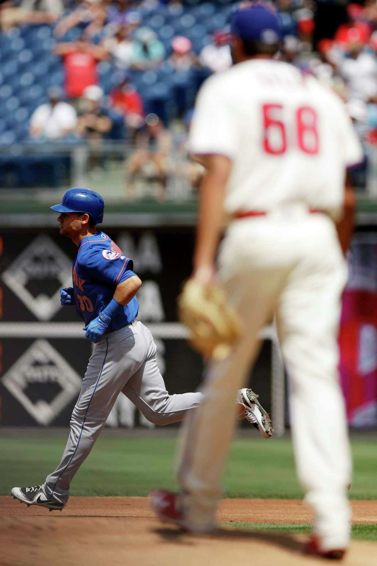 New York Mets' Michael Conforto, left, rounds the bases after hitting a two-run home run off Philadelphia Phillies starting pitcher Zach Eflin during the first inning of a baseball game, Sunday, Aug. 13, 2017, in Philadelphia. (AP Photo/Matt Slocum) ORG XMIT: PXS104