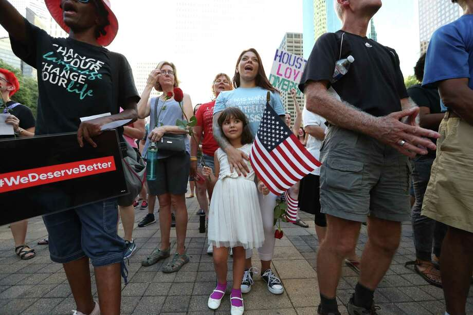 Alahna Kotinek, 6, and her mother, Kristin, joined in the vigil in solidarity with Charlottesville victims. Photo: Steve Gonzales, Staff / © 2017 Houston Chronicle
