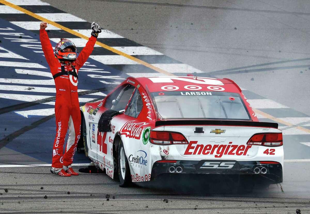 Kyle Larson celebrates winning a NASCAR Cup Series auto race in Brooklyn, Mich., Sunday, Aug. 13, 2017. (AP Photo/Paul Sancya) ORG XMIT: MIPS110
