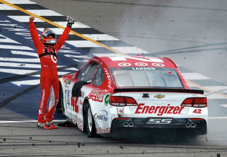 Kyle Larson celebrates winning a NASCAR Cup Series auto race in Brooklyn, Mich., Sunday, Aug. 13, 2017. (AP Photo/Paul Sancya) ORG XMIT: MIPS110 Photo: Paul Sancya / Copyright 2017 The Associated Press. All rights reserved.