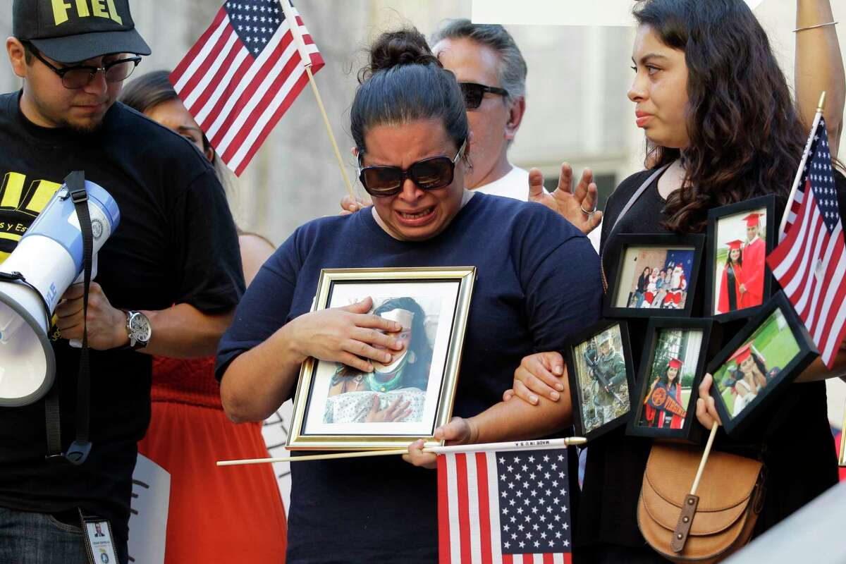 Ericka Chaves - whose daughter Natalie Romero, 20, was injured in Virginia - joins a vigil in Houston.