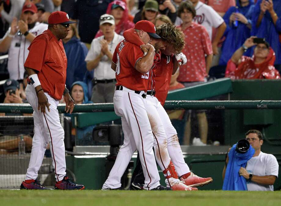 Washington Nationals' Bryce Harper, second from right, is helped off the field after he was injured during the first inning of a baseball game against the San Francisco Giants, Saturday, Aug. 12, 2017, in Washington. (AP Photo/Nick Wass) ORG XMIT: NAT105 Photo: Nick Wass / FR67404 AP