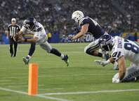 Seattle Seahawks quarterback Austin Davis dives forward at the end of run during the second half of an NFL preseason football game against the Los Angeles Chargers Sunday, Aug. 13, 2017, in Carson, Calif. (AP Photo/Jae C. Hong)
