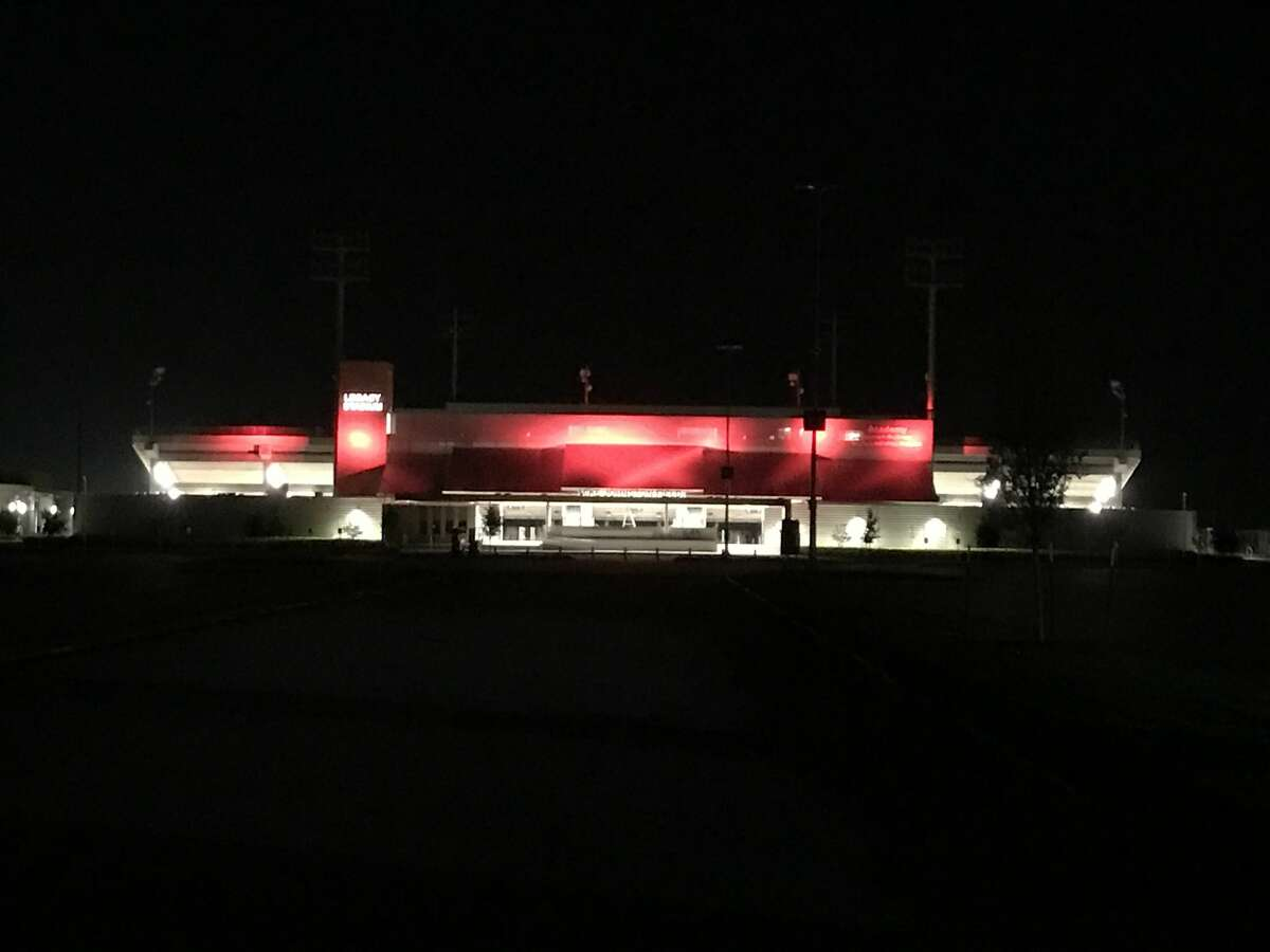 At night, different color lights - representing the different schools in Katy ISD - illuminate Katy's Legacy Stadium. On Saturday night, the stadium was lit red for Katy High School. The stadium will host its first varsity football game on Thursday, Aug. 31, 2017 when Katy Taylor plays Foster.