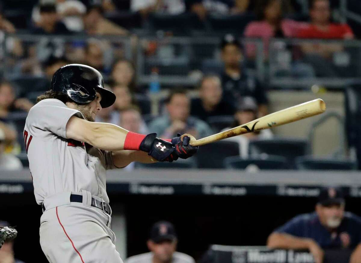 Boston Red Sox's Andrew Benintendi follows through on an RBI single during the 10th inning of a baseball game against the New York Yankees on Sunday, Aug. 13, 2017, in New York. (AP Photo/Frank Franklin II) ORG XMIT: NYY118