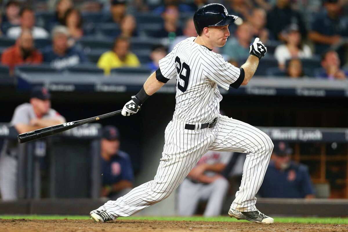 NEW YORK, NY - AUGUST 13: Todd Frazier #29 of the New York Yankees hits a RBI sacrifice fly in the eighth inning against the Boston Red Sox at Yankee Stadium on August 13, 2017 in the Bronx borough of New York City. (Photo by Mike Stobe/Getty Images) ORG XMIT: 700012008