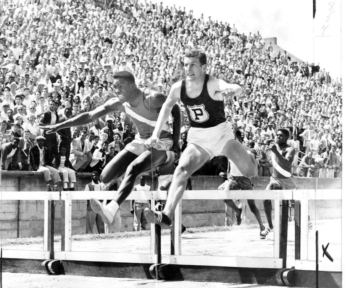 Monte Upshaw of Piedmont High School in the low hurdles dueling with Rafer Johnson of Kingsburg at the California state high school track meet May 29, 1954. Upshaw would narrowly beat Johnson in the race.