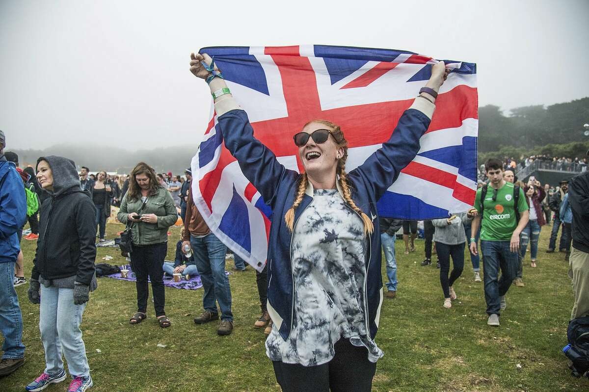 A festival-goer dances while holding a Union Jack during the The Who performance at the Outside Lands Music Festival at Golden Gate Park on Sunday, Aug. 13, 2017, in San Francisco. (Photo by Amy Harris/Invision/AP)