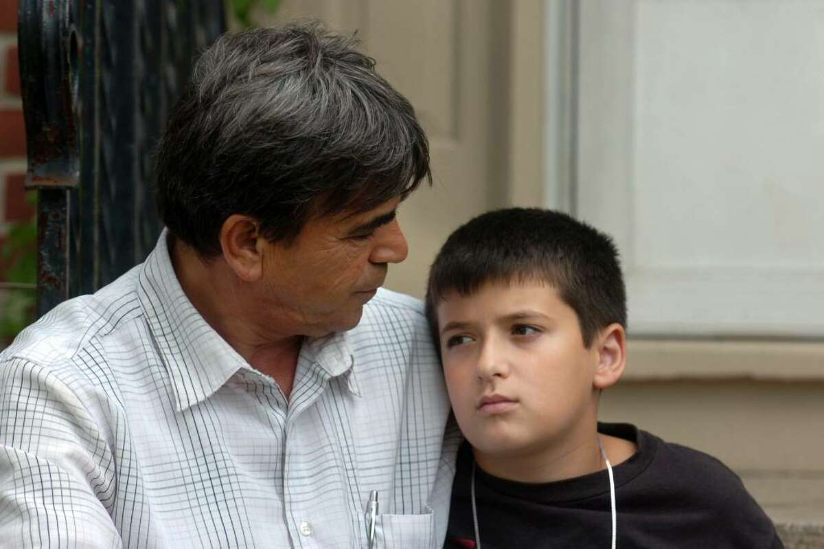 Skender Emini sits with his nephew Dorart Emini, 11, in front of the Emini home, in Naugatuck, Conn. Thursday, June 17th, 2010. Aferdita and her three siblings will leave for Serbia with their uncle on Saturday.