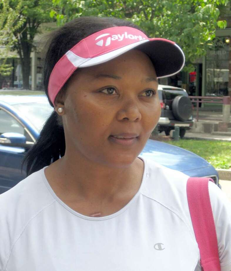 Busi Dlamini, 36, of Danbury, said she is not happy because she misses her family in South Africa. Photo: Vinti Singh, Vinti Singh / The News-Times File Photo