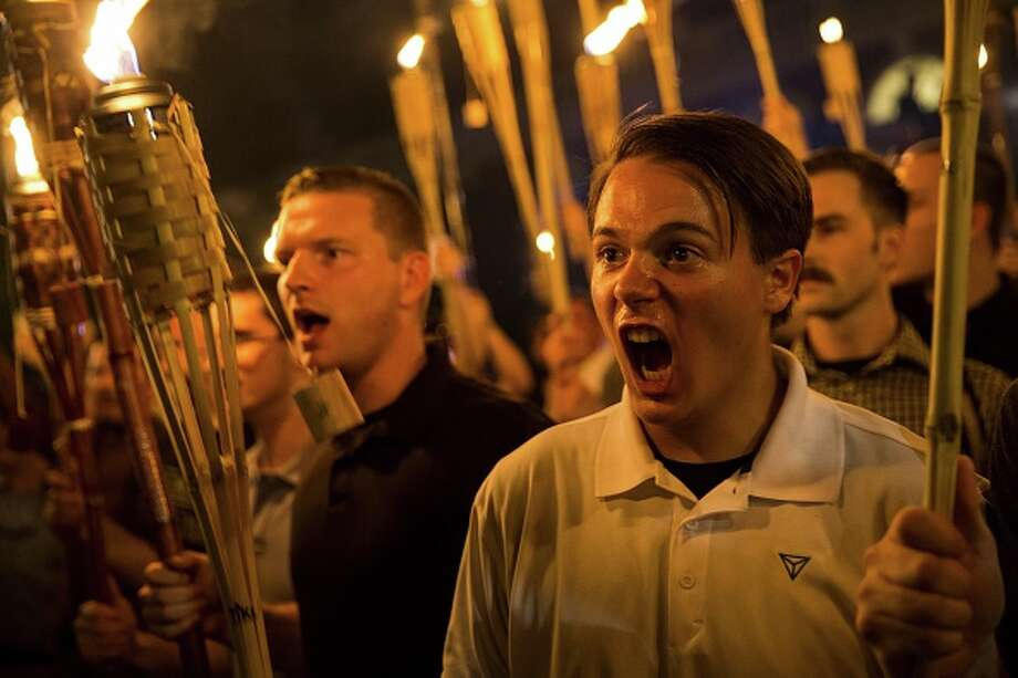 Neo Nazis, Alt-Right, and White Supremacists encircle and chant at counter protestors Aug. 11, 2017.Peter Cvjetanovic, 20, is speaking out after being identified as a University of Nevada, Reno student. Photo: Anadolu Agency/Getty Images