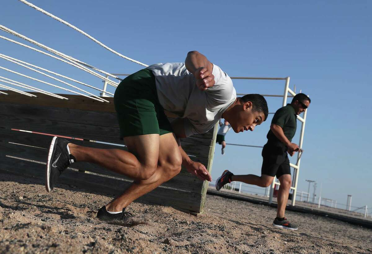 A U.S. Border Patrol trainee runs an obstacle course at the U.S. Border Patrol Academy on August 3, 2017 in Artesia, New Mexico.