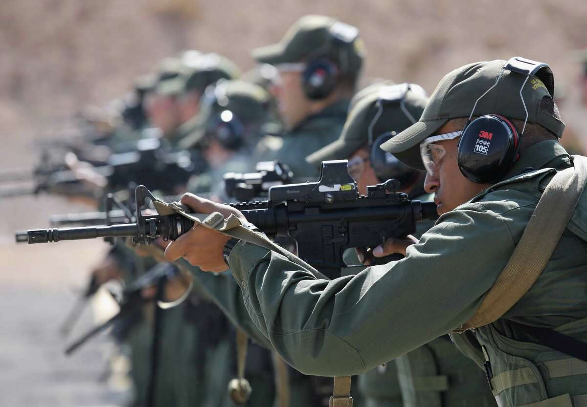 U.S. Border Patrol trainees fire M-4 rifles during a weapons training class at the U.S. Border Patrol Academy on August 3, 2017 in Artesia, New Mexico.