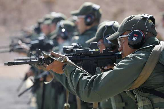 ARTESIA, NM - AUGUST 03:  U.S. Border Patrol trainees fire M-4 rifles during a weapons training class at the U.S. Border Patrol Academy on August 3, 2017 in Artesia, New Mexico. All new agents must complete a rigorous months-long training course at the New Mexico facility before assuming their posts at Border Patrol stations, mostly along the U.S.-Mexico border. President Trump has pledged to add an additional 5,000 agents to the existing Border Patrol force of more than 21,000 as part of his border security policy.  (Photo by John Moore/Getty Images)