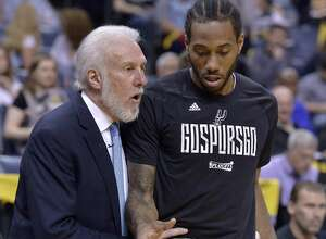 Gregg Popovich talks to Kawhi Leonard during the playoffs. Both men rank high on the list of local sports luminaries.