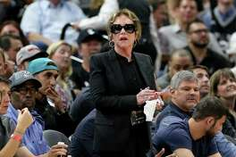 Spurs chairman and CEO Julianna Hawn Holt stands during second half action of Game 2 in the Western Conference semifinals between the San Antonio Spurs and Oklahoma City Thunder Monday May 2, 2016 at the AT&T Center. The Thunder won 98-97.