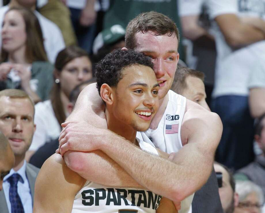 Michigan State's Bryn Forbes (left) and Matt Costello during a 2016 win. Photo: Al Goldis /Associated Press / FR11125 AP