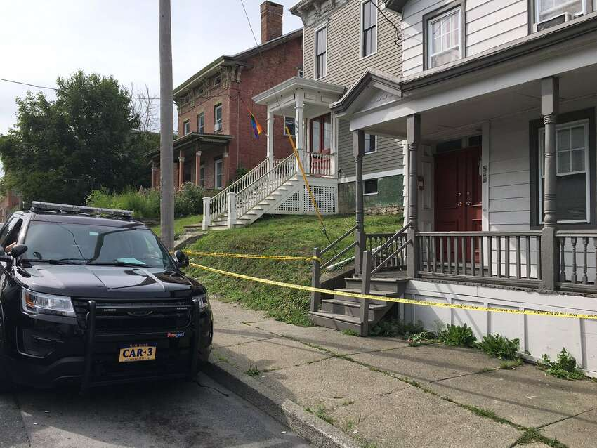 Gunfire broke out just before 9 p.m. Sunday in front and behind this State Street home, Hudson police said. Evidence technicians were sweeping the scene Monday morning, Aug. 14, 2017. (Emily Masters/Times Union)