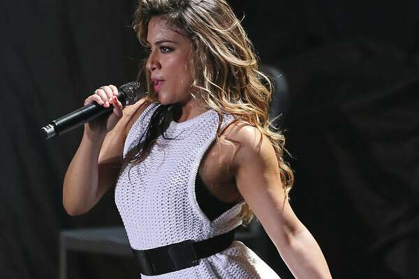 Fifth Harmony's Ally Brooke performs with the group Friday July 25, 2014 at the Freeman Coliseum.