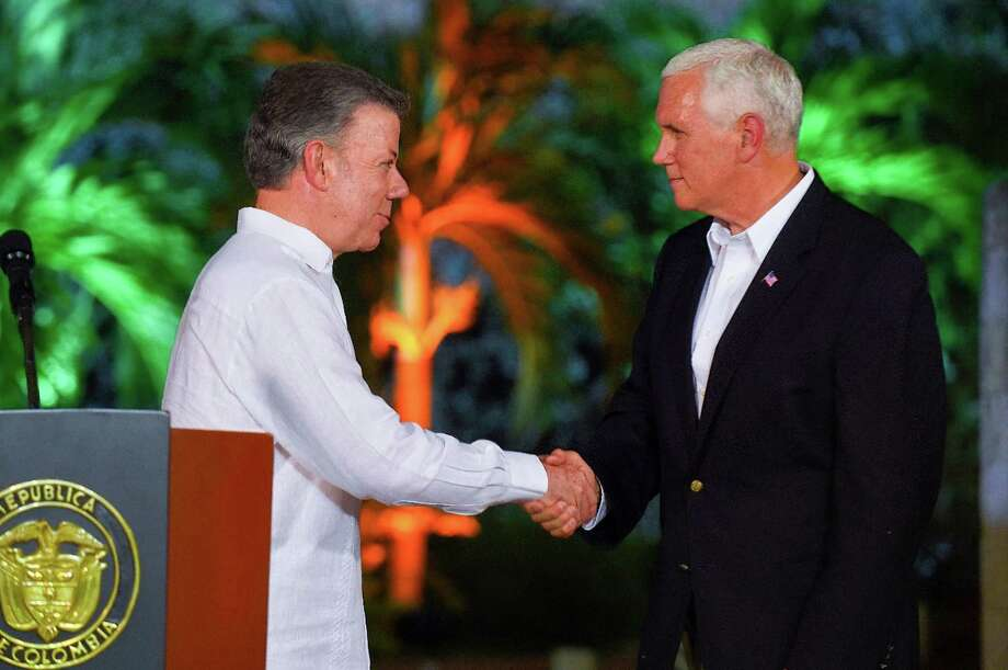Vice President Mike Pence, shown with Colombian President Juan Manuel Santos, is visiting South and Central America. Photo: Getty Images / AFP or licensors