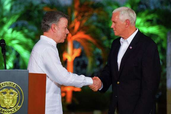 Vice President Mike Pence, shown with Colombian President Juan Manuel Santos, is visiting South and Central America.