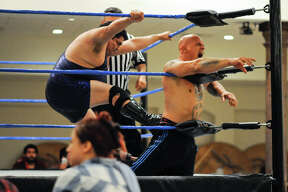 LGPW wrestlers put on a show for the crowd at Royal Reception Hall on Sunday, August 13, 2017 during the LGPW's Summer of Pain wrestling event.