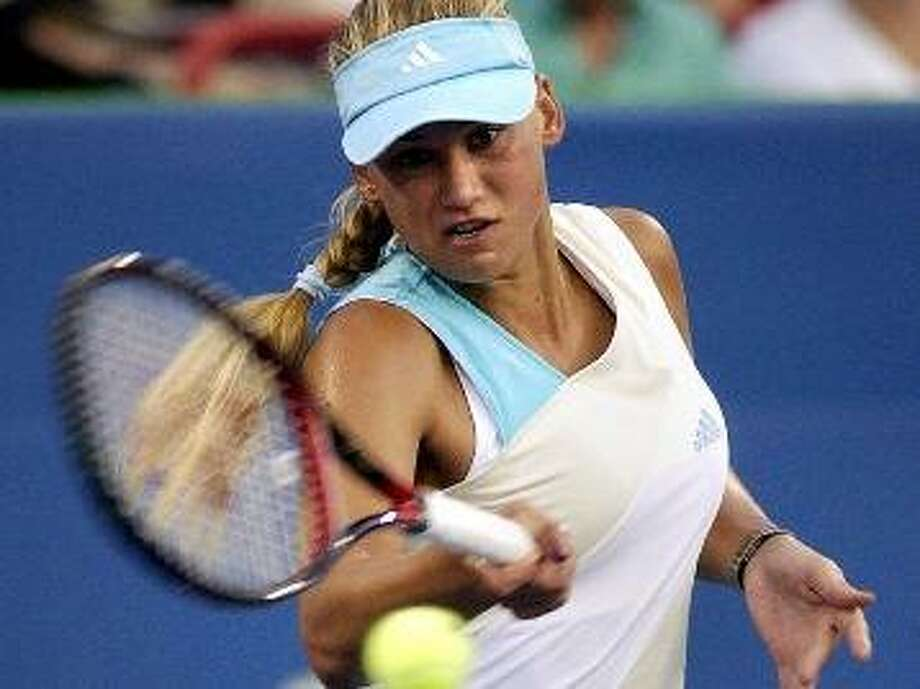 Anna Kournikova returns a serve to Saori Obata during her first-round 6-3, 6-1 win at the Canadian Open on Aug. 12, 2002, in Montreal, at the Rogers AT&T tournament. Photo: Marcos Townsend /Associated Press