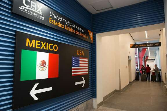 Travelers leave Mexico for the United States as they use the Cross Border Xpress pedestrian bridge in Tijuana, Mexico on June 8, 2017. Mexican officials arrive in Washington this week to begin rewriting the terms of the North American Free Trade Agreement. (Benedicte Desrus/Sipa USA/TNS)