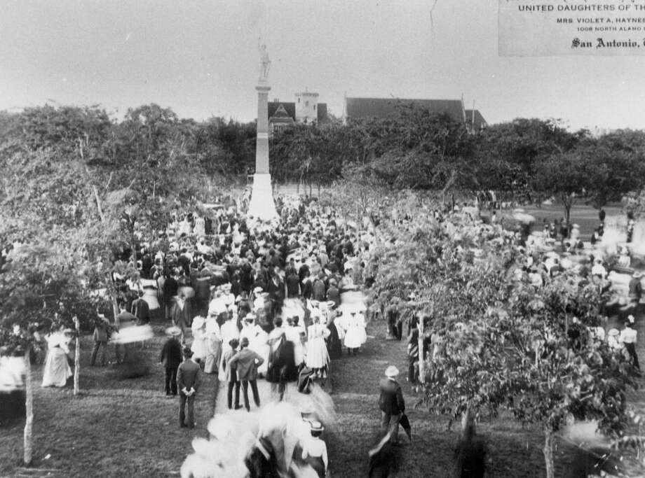Dedication of the Confederate monument at Travis Park: Named for the commander at the Alamo, Travis Park has been a San Antonio landmark since the 1870s. The park is located on a former orchard owned by Samuel Maverick. Like many Confederate monuments, the one at Travis Park -- dedicated in 1900 --faces South. Photo: Saen File Photo / Express-News File Photo / San Antonio Express-News