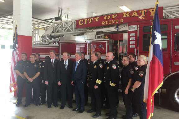 U.S. Rep. Michael McCaul, R-TX, joins Katy Mayor Chuck Brawner and Katy Fire Department personnel to announce a new federal grant that will award the department $2.2 million for additional personnel.