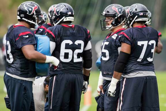 The Houston Texans offensive line gets ready for a drill during training camp at The Greenbrier on Monday, Aug. 14, 2017, in White Sulphur Springs, W.Va.