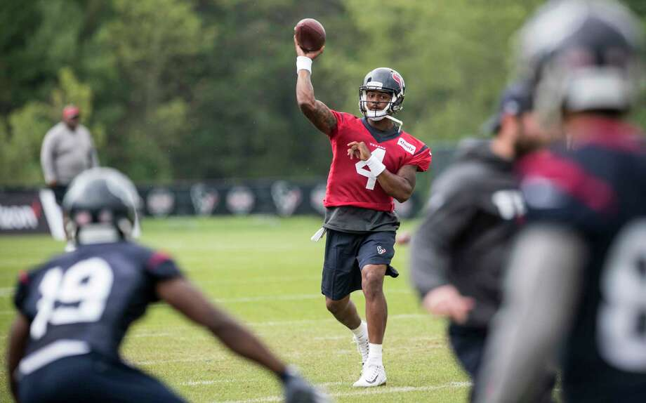 Houston Texans quarterback Deshaun Watson (4) throws a pass to wide receiver Justin Hardee (19) during training camp at The Greenbrier on Monday, Aug. 14, 2017, in White Sulphur Springs, W.Va. Photo: Brett Coomer, Houston Chronicle / © 2017 Houston Chronicle}