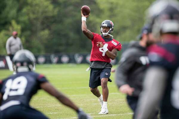 Houston Texans quarterback Deshaun Watson (4) throws a pass to wide receiver Justin Hardee (19) during training camp at The Greenbrier on Monday, Aug. 14, 2017, in White Sulphur Springs, W.Va.