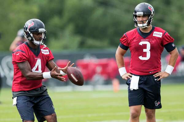 Houston Texans quarterback Deshaun Watson (4) takes a snap as quarterback Tom Savage looks on during training camp at The Greenbrier on Monday, Aug. 14, 2017, in White Sulphur Springs, W.Va.