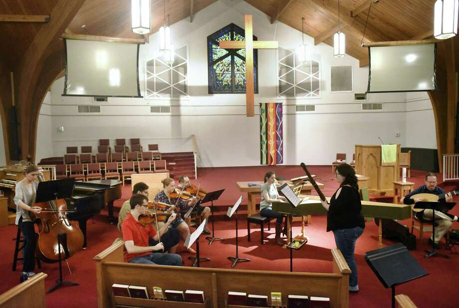 Members of L'Estro Barocco rehearse at Covenant Presbyterian Church on Thursday. The baroque music ensemble was founded by Hector Serna, who plays violin. Photo: Billy Calzada /San Antonio Express-News / San Antonio Express-News