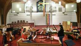 Members of L'Estro Barocco rehearse at Covenant Presbyterian Church on Thursday. The baroque music ensemble was founded by Hector Serna, who plays violin.