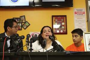 Ericka Chaves (center) is flanked by Cesar Espinosa (left) and her son Sebastian as she talked about her daughter Natalie Romero Monday, Aug. 14, 2017, in Houston.  Romero was amongst those injured in Charlottesville Virginia on August 12, 2017. She has suffered extensive injuries including a fractured skull. It is the mother's wish that her daughter may return home so she can look after her daughter.