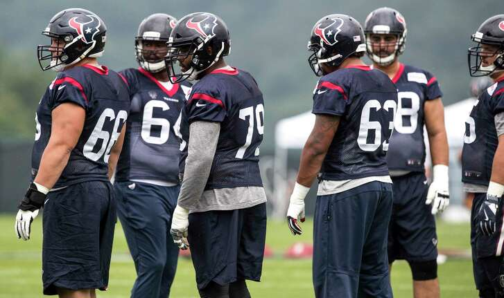 Houston Texans offensive linemen Breno Giacomini (68), Laurence Gibson (64), Jeff Allen (79), Kendall Lamm (63) and Greg Mancz (65) line up to run a drill during training camp at The Greenbrier on Monday, Aug. 14, 2017, in White Sulphur Springs, W.Va.