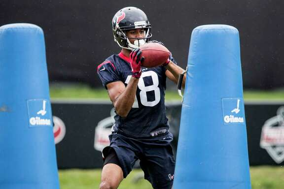 Houston Texans wide receiver Devin Street (18) makes a catch while running a drill around tackling dummies during training camp at The Greenbrier on Monday, Aug. 14, 2017, in White Sulphur Springs, W.Va.