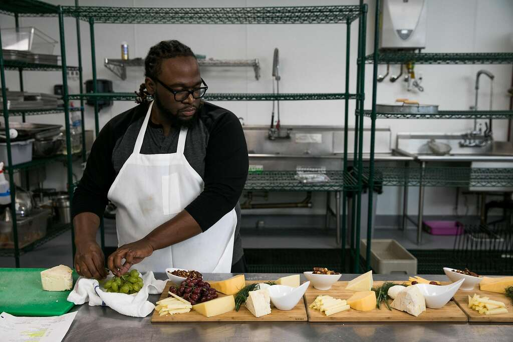 Assistant chef Chris Taylor prepares dishes for an upcoming event at Red Door Catering in Oakland & Red Door Catering in Oakland opens an unexpected career - San ... pezcame.com