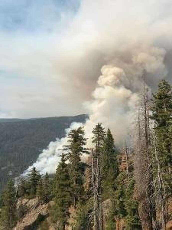 The South Fork Fire, burning along the Merced River's south fork in Yosemite National Park, grew overnight Sunday to 900 acres.