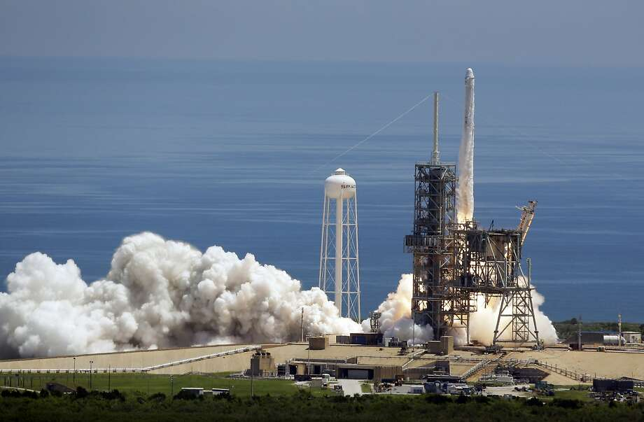 A Falcon 9 SpaceX rocket carrying a capsule loaded with science research and ice cream for the international space station takes off from Cape Canaveral. Photo: John Raoux, Associated Press