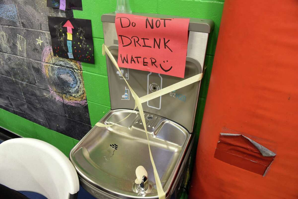 Sign placed above a water fountain in the Mechanicville Community Center warns not to drink the water on Monday, Aug. 14, 2017, in Mechanicville, N.Y. (Will Waldron/Times Union)