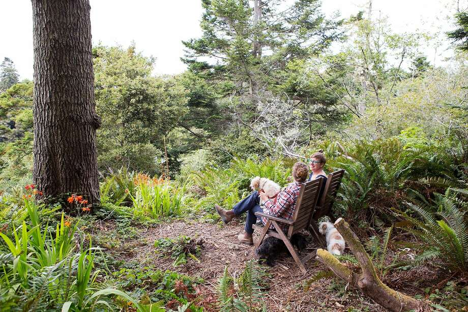 Colleen Hennessey and wife Adele Horne relax in the spot on their property where they can see the ocean. Photo: Vivian Johnson, Special To The Chronicle
