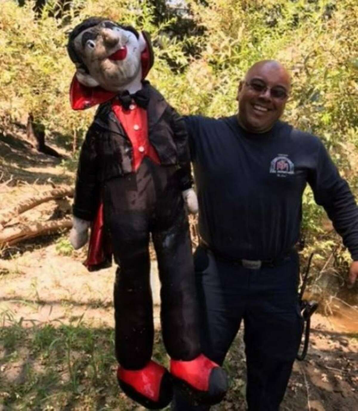 Capt. Jair Juarez of the Modesto Fire Department holds up the life-size Dracula doll that a winery employee thought might be a body floating on Dry Creek.