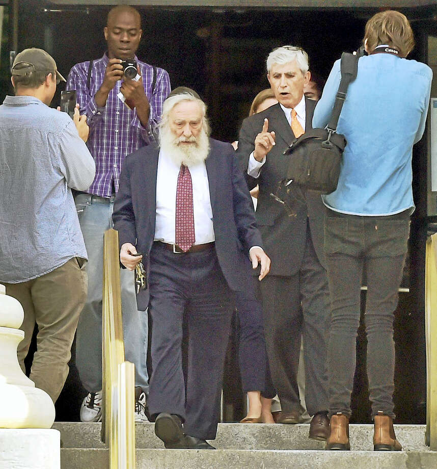 Rabbi Daniel Greer, 77, of New Haven,  third from left, leaves New Haven Superior Court Monday with his attorney William Dow III, of New Haven, after he appeared in court on charges of second-degree sexual assault and risk of injury to a minor. Greer did not enter a plea. The alleged victim in the criminal charge is  Eliyahu Mirlis, of New Jersey,  who was awarded $15 million in his civil lawsuit against Greer in May 2016. Greer was a dean of the Yeshiva of New Haven/the Gan School, where the alleged victim was a high school student. Greer is accused i sexually assaulting Mirlis over several years in the early- to mid-2000s. Mirlis attended the school from 2001 to 2005. Greer has denied the allegations. Photo: Peter Hvizdak / Hearst Connecticut Media / New Haven Register