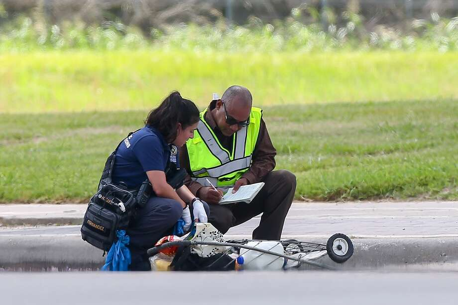 Authorities investigate the scene where a pedestrian was fatally struck by a city garbage truck at the intersection of Gessner Road and Bellaire Boulevard  Monday, Aug. 14, 2017, in Houston. Photo: Godofredo A. Vasquez / Houston Chronicle